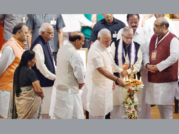 BJP President Amit Shah lights the lamp