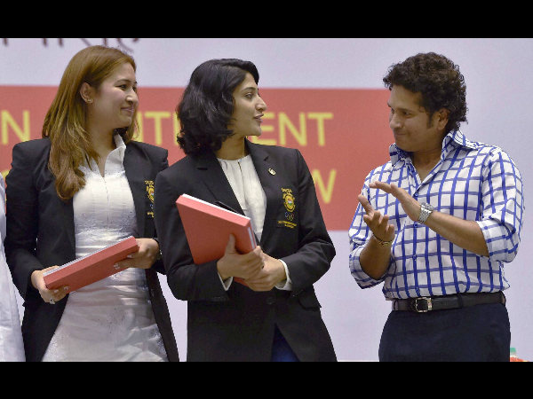 Cricket legend Sachin Tendulkar claps as silver medalist shuttlers Jwala Gutta and A Ponnappa being honored during a felicitation programme for the India's contingent for the Commonwealth Games 2014, in New Delhi on Friday.