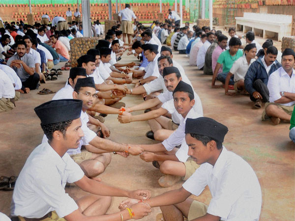 RSS members trying rakhi on each others wrist