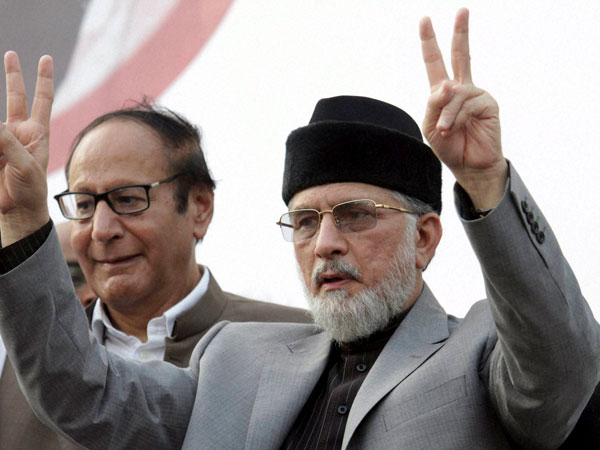 Tahir-ul-Qadri flashes victory sign