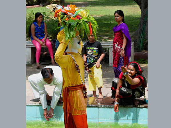 Devotees pay obeisance to Lord Krishna during Janmashtami celebrations