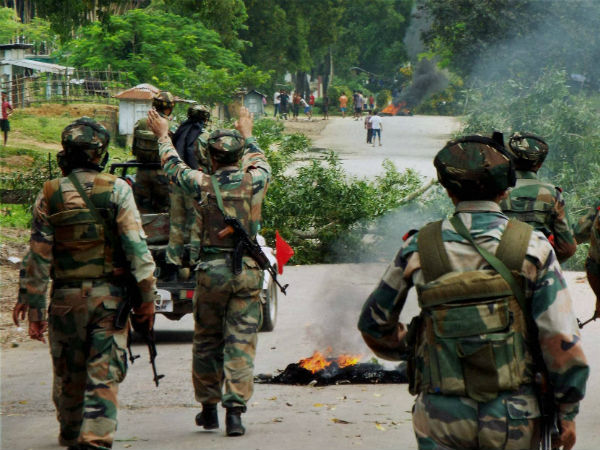 Army soldiers keep vigil in action following violent protests at Telgaram Numaligarh in tension-gripped Golaghat district in Assam. (PTI Photo)