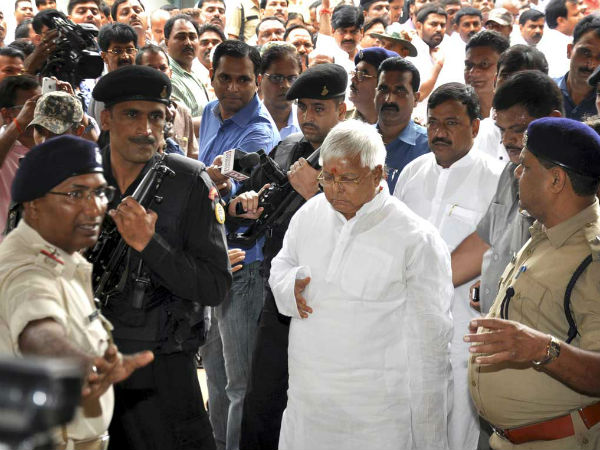 Lalu Prasad Yadav with the security cover. (PTI Photo)