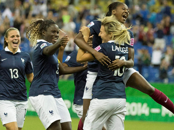France's Claire Lavogez (10) is mobbed by teammates