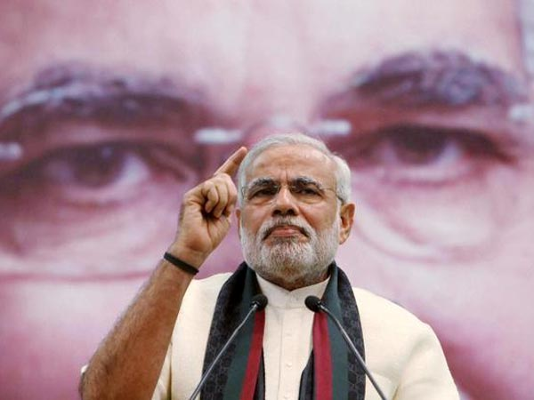China reacts guardedly to Modi's remarks