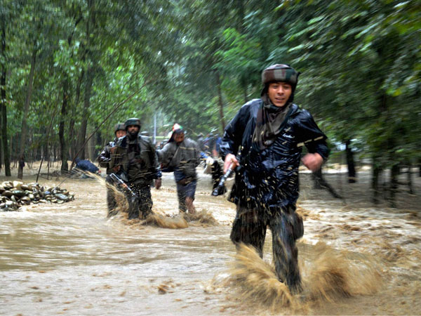 Army personnel rescuing flood-affected villagers