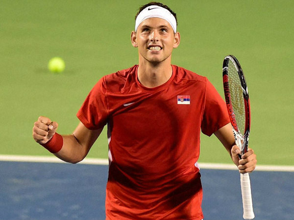 Serbia's Filip Krajinovic celebrates after defeating India's Somdev Devvarman