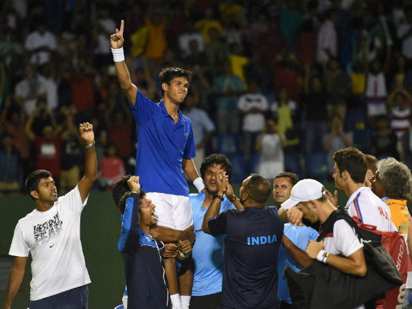 India's Somdev Devvarman celebrates with team mates after winning against Serbia's Dusan Lajovic