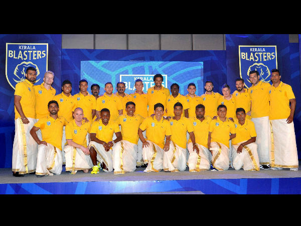 Members of Sachin Tendulkar's football team Kerala Blasters pose for a photograh after the launch of their logo in Kochi on Monday.