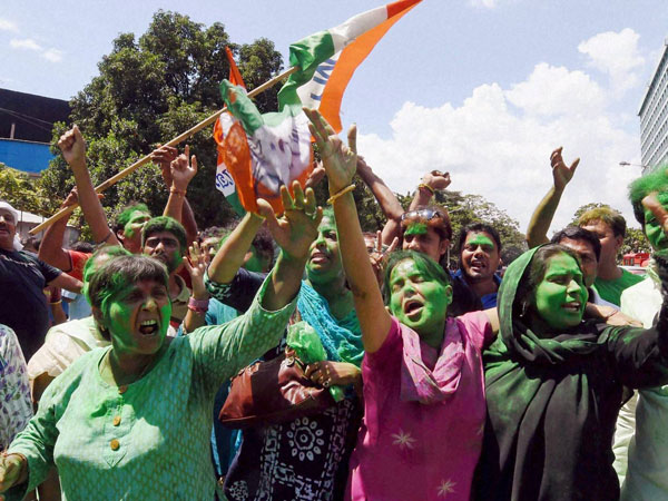 Trinamool Congress supporters celebrate their victory