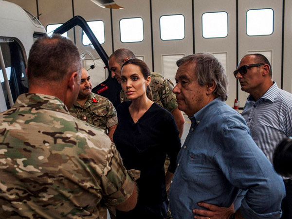 Valetta : In this image made available from the UNHCR on Monday Sept. 15, 2014 American actress, Angelina Jolie, centre, who serves as Special Envoy for the United Nations High Commission for Refugees, listens to officers in the Maltese military discuss rescue at sea operations for refugees at a military base in Valetta, Malta on Sunday, Sept. 14, 2014. Since the start of 2014, more than 2,500 asylum seekers have perished trying to cross the Mediterranean.