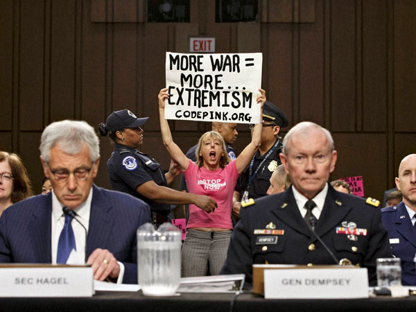 Anti-war activist disrupt hearing