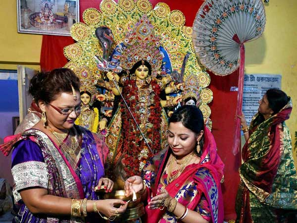 Durga puja starts in the tradional household puja