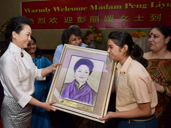 China's first lady Peng Liyuan is presented