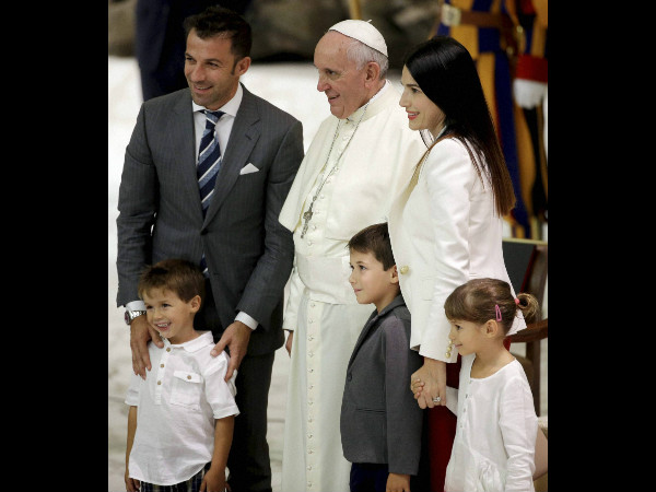 File photo: Pope Francis poses for a picture with Italian soccer star Alessandro Del Piero and his family, in the Paul VI hall at the Vatican, Monday, September 1, 2014
