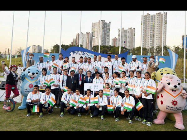 Indian athletes pose with the official mascot of the games during the flag hoisting ceremony of 17th Asian Games in Incheon, South Korea on Thursday.