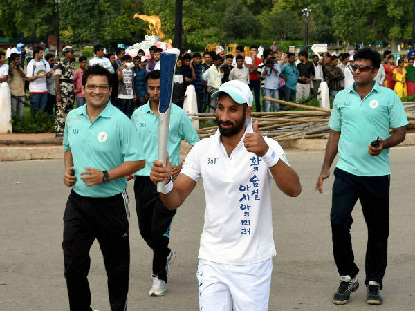 India's hockey captain Sardar Singh during the torch relay ceremony of 17th Asian Games - 2014 at Rajpath in New Delhi last month.