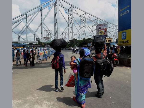 Passengers walk out of the Howrah Station