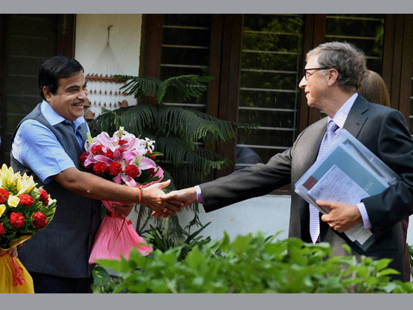 Union Transport Minister Nitin Gadkari shakes hands with Bill Gates