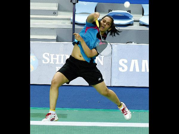India's Saina Nehwal plays a shot against Thailand's R Invtanon during their singles quarterfinal match at Asian Games 2014 in Incheon. Saina won