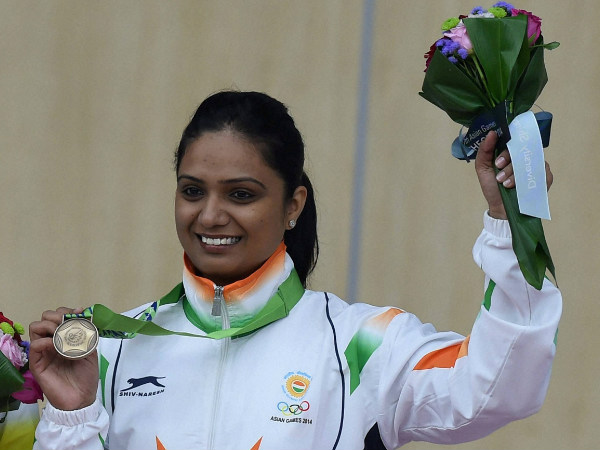 Shweta Chaudhry poses with her bronze medal in Incheon
