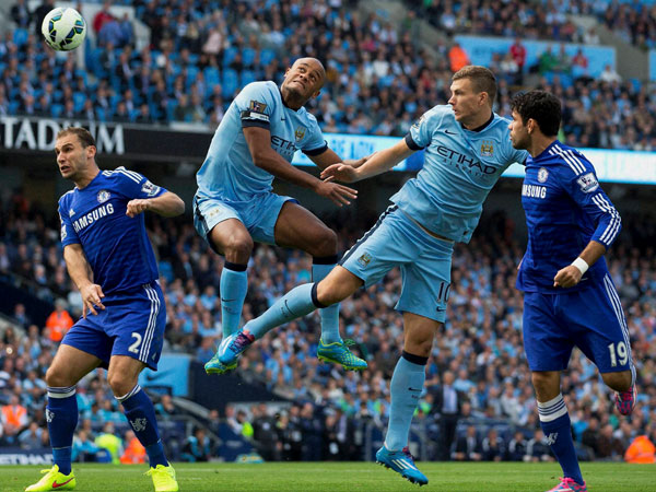 Manchester City's Edin Dzeko, second right and Vincent Kompany