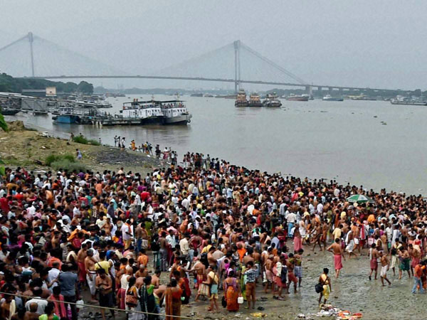 Devotees gather at the bank of River Ganga