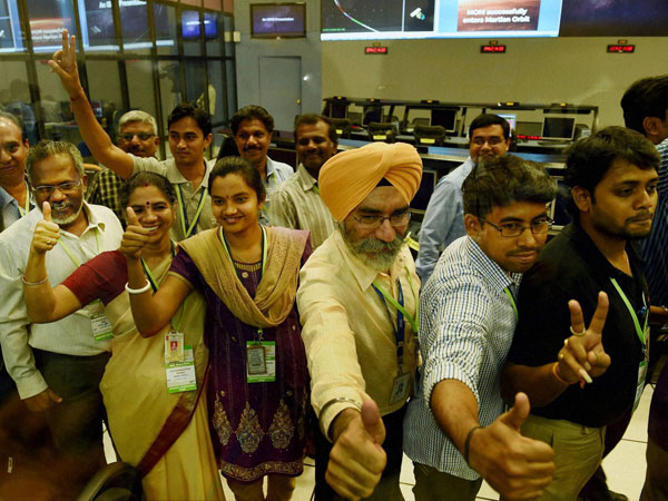 ISRO scientists and other officials celebrate the success