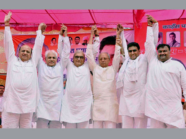 Haryana CM Bhupinder Singh Hooda with party candidates