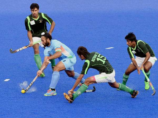 India's Sardar Singh dribbles past Pakistani player during their Pool B hockey match at 17th Asian Games in Incheon, on Thursday.