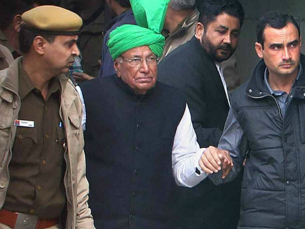 On January 22, 2014 the trial court convicted and sentenced Chautala and nine others to ten years jail-term for illegally recruiting 3,206 junior teachers.