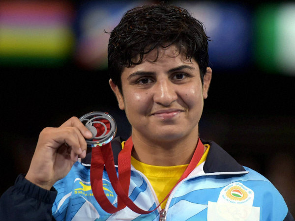 File photo of India's Geetika Jakhar with her Silver medal at the Glasgow Commonwealth Games last month. She won bronze in Incheon Asian Games today