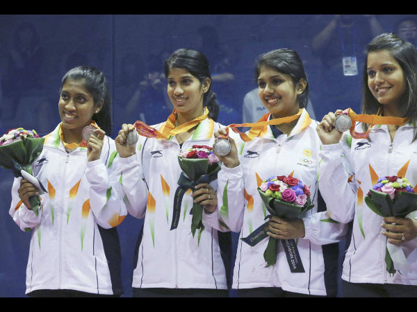 Anaka Alankamony, Joshna Chinappa, Aparajitha Balamurukan and Deepika Pallikal pose with their silver medals during the women's team squash award ceremony at the 17th Asian Games in Incheon on Saturday.