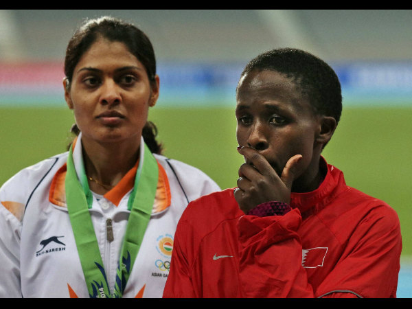 Bahrain's Ruth Jebet, right, reacts in front India's Lalita Shivaji Babar after hearing an oficial announcment to postpone the Women's 3000 meters steeplechase medal ceremony during the 17th Asian Games in Incheon, South Korea on Saturday.