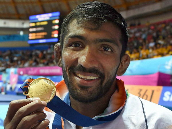India's Yogeshwar Dutt poses with his gold medal after winning the men's 65 kg freestyle wrestling match at Dowon Gymnasium Stadium at Asian Games in Incheon on Sunday.