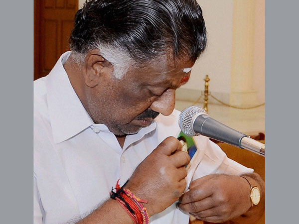 AIADMK leader O Panneerselvam puts a picture