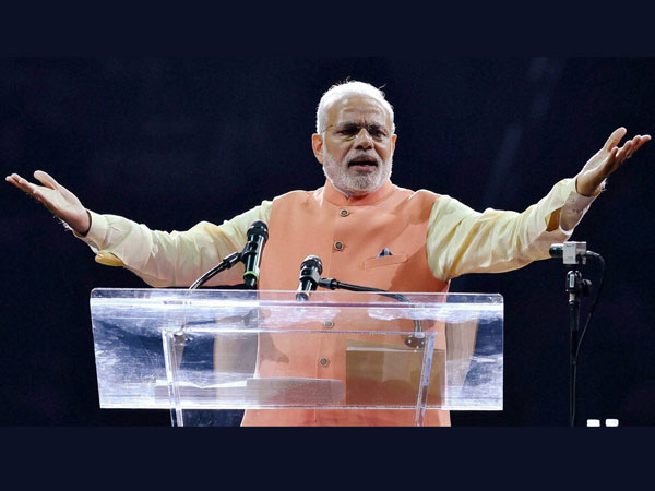 Prime Minister Narendra Modi gestures while addressing the audience