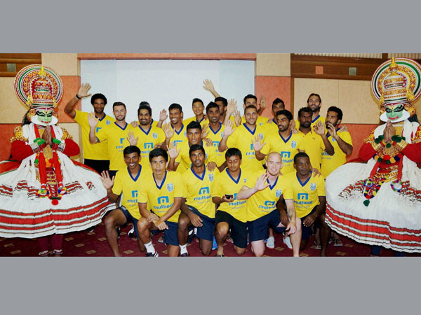 Players of Kerala Blaster football team pose