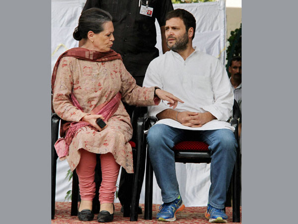 Congress President Sonia Gandhi talks to party Vice President Rahul Gandhi