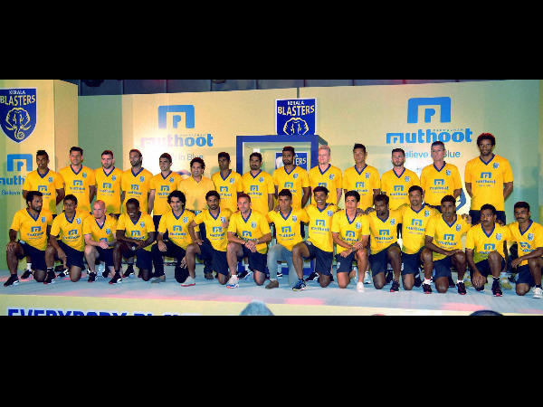 Cricket legend and owner of Kerala Blasters football team Sachin Tendulkar (back row, sixth from left) at a photo session with team during the inaugural ceremony of the team jersey in Kochi on Monday.