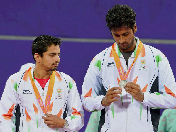 Saketh Myneni (right) and Sanam Singh at the medal ceremony after they claimed silver medal in Men's doubles at Asian Games in Incheon on Monday.