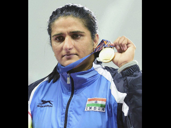 India's gold medallist Seema Punia stands on the podium during the medal ceremony for women's discus throw