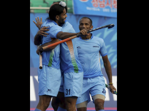 India's Akashdeep Singh (left) celebrates with his team mates after scoring a goal against South Korea during their Men's Hockey semifinal match at the Asian Games in Incheon on Tuesday. India won 1-0 to enter the final.