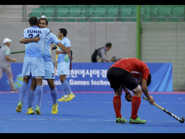 India's Sunil Vitalacharya Sowmarpet and goal scorer Akashdeep Singh celebrate their victory over South Korea during their Men's Hockey semi-final match at the Asian Games in Incheon on Tuesday.