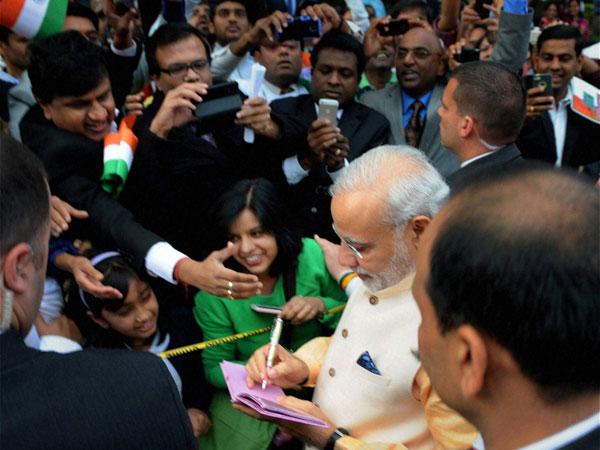 NaMo meets children of Indian officials