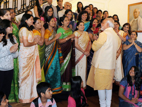Modi greeted by Indian officials families