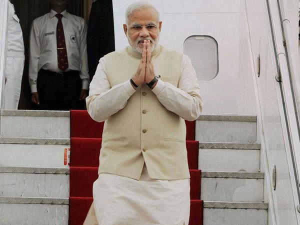 Modi arrives in Frankfurt on way home