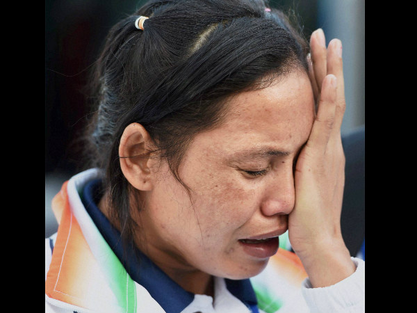Indian boxer Lalshram Sarita Devi is in tears after she was knocked out of the 60 kg boxing semifinal bout against Korea at the Asian Games in Incheon on Tuesday.