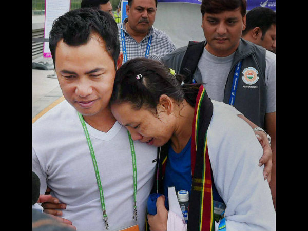 Indian boxer Lalshram Sarita Devi being consoled by her husband after she was knocked out of the 60 kg boxing semifinal bout against Korea at the Asian Games in Incheon on Tuesday.