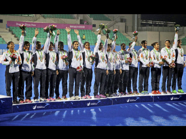 Indian women hockey players celebrate with their bronze medals during the victory ceremony for the women's hockey at the 17th Asian Games in Incheon, South Korea on Wednesday.